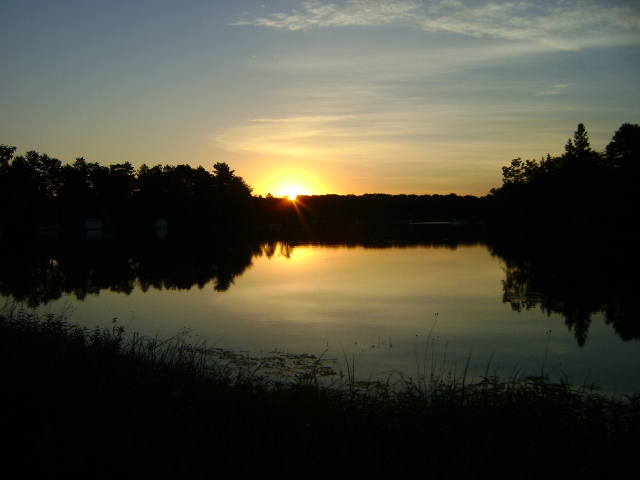 Sunrise over Round & Lime Kiln Lake off County Road Q at Indian Crossing Bridge.